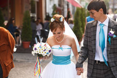 Happy couple walking  down the street and smiling.  Royalty Free Stock Photos