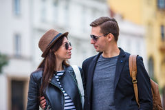 Happy couple walking in Europe. Smiling lovers enjoying cityscape with famous landmarks. Stock Photo