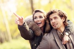 Happy couple walking in the forest during autumn. Picture showing happy couple walking in the forest during autumn Royalty Free Stock Photography