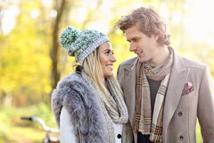 Happy couple walking in the forest during autumn. Picture showing happy couple walking in the forest during autumn Stock Photo