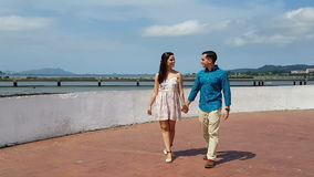 Happy couple walking in hand outdoors stock footage