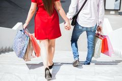 HAPPY COUPLE WALKING AND HOLDING HANDS Royalty Free Stock Photo