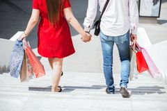 Happy couple walking holding hands Royalty Free Stock Photography