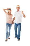 Happy couple walking holding hands Stock Image