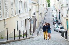 Happy couple walking on Montmarte Stock Photography