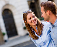 Happy couple walking outdoors Stock Image