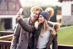Happy couple walking outdoors in winter Stock Photos