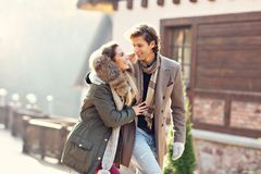 Happy couple walking outdoors in winter Royalty Free Stock Image
