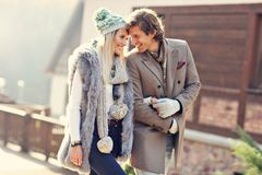 Happy couple walking outdoors in winter Stock Photo