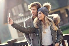 Happy couple walking outdoors in winter Stock Image