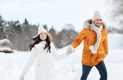 Happy couple walking over winter background Stock Image