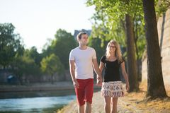 Happy couple walking on Parisian embankment Stock Image