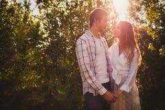 Happy couple walking at park Stock Image