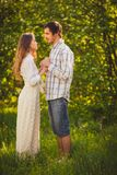 Happy couple walking at park Royalty Free Stock Photography