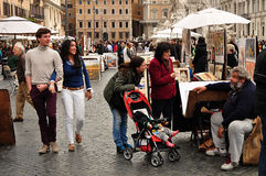 Happy couple walking on Piazza Navona Stock Photography