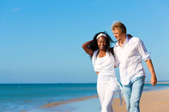 Happy couple walking and running on beach Royalty Free Stock Photography