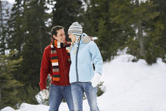 Happy Couple Walking On Snow Royalty Free Stock Image