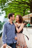 Happy couple walking on a street Royalty Free Stock Photography