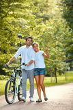 Happy Couple walking in summer park. Stock Photos