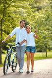 Happy Couple walking in summer park. Stock Image