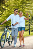 Happy Couple walking in summer park. Royalty Free Stock Photos