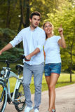 Happy Couple walking in summer park. Royalty Free Stock Image