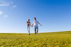 Happy couple walking together Royalty Free Stock Photos