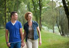 Happy couple walking together outdoors Royalty Free Stock Image