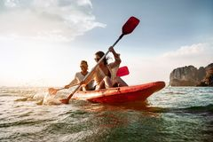 Happy couple walks by sea kayak or canoe. At tropical bay royalty free stock images