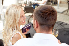 Happy couple with wallet paying bill at restaurant Stock Images