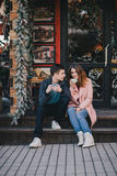 Happy couple in warm clothes drinking coffee on a Christmas market Royalty Free Stock Image