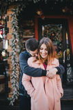 Happy couple in warm clothes posing on a Christmas market Royalty Free Stock Photo