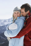 Happy Couple In Warm Clothing Embracing Royalty Free Stock Photos