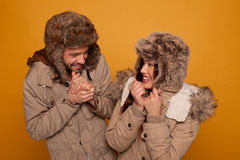 Happy couple in warm winter clothing Stock Photos
