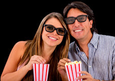 Happy couple watching a 3D movie Royalty Free Stock Photo