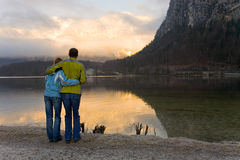 Happy couple watching the lake. Picture of me and my girlfriend. It has been shot very early in the morning, just at the sunrise. The view was beautiful, and we Stock Image