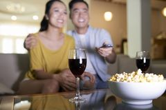 Happy couple watching movie at home stock photos