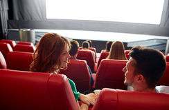 Happy couple watching movie in theater or cinema Stock Image