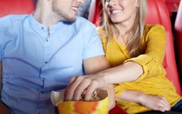Happy couple watching movie in theater or cinema Royalty Free Stock Photos