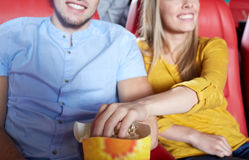 Happy couple watching movie in theater or cinema Stock Photo