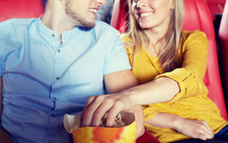 Happy couple watching movie in theater or cinema Stock Images