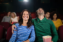 Couple watching movie in theatre. Happy couple watching movie in theatre Stock Images
