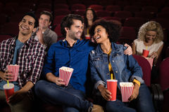 Couple watching movie in theatre. Happy couple watching movie in theatre Stock Photography