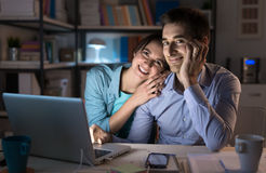 Happy couple watching movies online Royalty Free Stock Image
