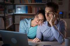 Happy couple watching movies online Royalty Free Stock Photo
