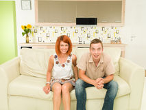 Happy couple watching television Royalty Free Stock Image