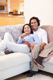 Happy couple watching television together Royalty Free Stock Photo