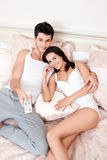 Happy couple watching television together Stock Image