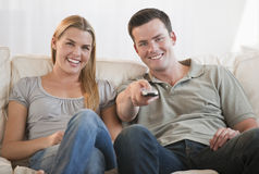 Happy Couple Watching TV Royalty Free Stock Photography
