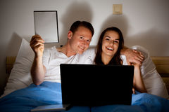 Happy Couple Watching A Video Royalty Free Stock Photos